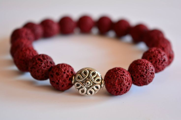 Charm Bracelet made fro red lava stone beads.