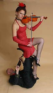 """Strings on Fire's """"Liqueur Flambe"""" Show.  Guaranteed to set your event apart from the rest.  In fact, Australia's most unique & unusual events duo will SET YOUR NIGHT ON FIRE!"""