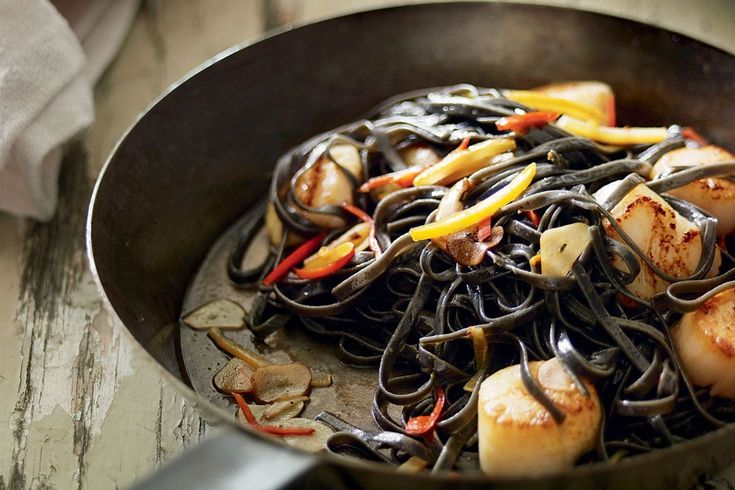 Simple scallops pair beautifully with dark squid ink linguine and preserved lemon. If you can't find an ink-stained pasta, regular linguine will work just as well.