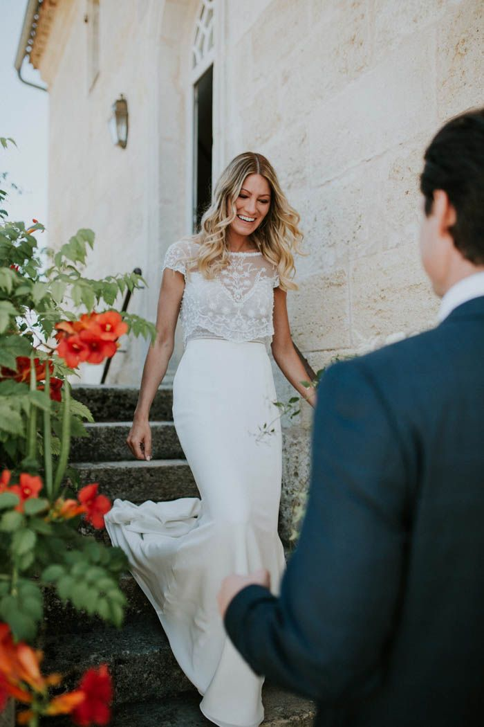 Two piece lace and silk wedding dress | Image by Yoris Photographe