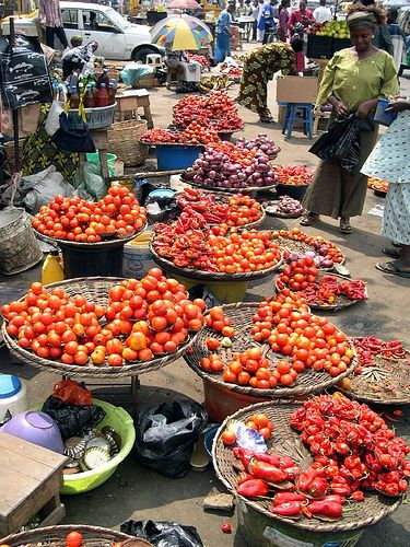 Tomatoes and peppers for sale at a street market in Lagos, Nigeria http://www.flickr.com/photos/alunjohn/1456621151/