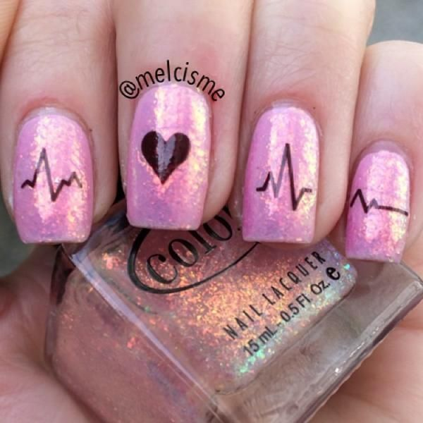Heart rate/pulse nails with a shiny glitter topped for Valentine's Day by @Melissa Squires.