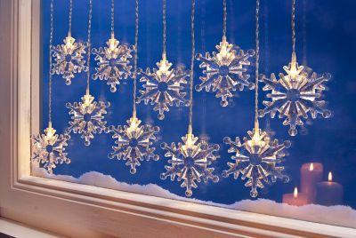 Schneeflocken Lichtervorhang • 10 Stränge, je mit klarem Schneeflocken-Aufsatz • Jede »Schneeflocke« beleuchtet von warmweißer LED • Lichtervorhang sowohl innen als auch außen einsetzbar
