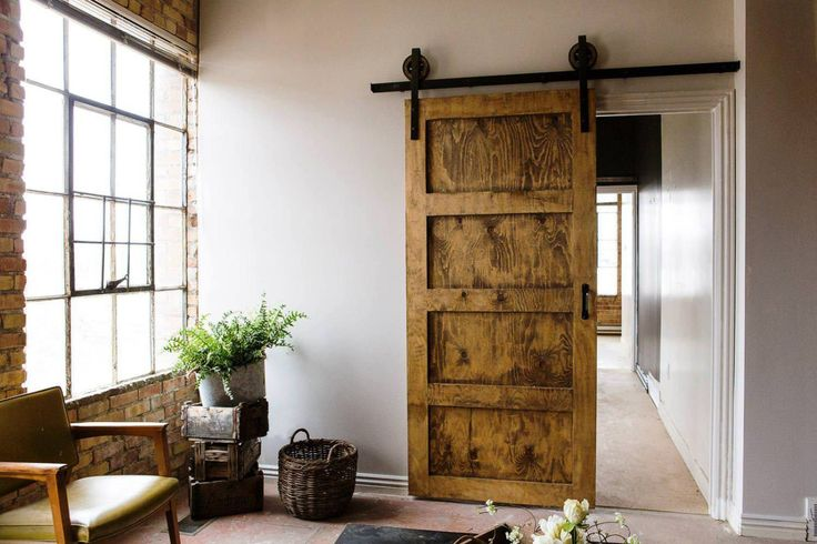 Create Beautiful Space Using Barn Doors Interior: French Window And Brick Accent Walls With Planter Also Barn Doors Interior And Tile Floors With Door Molding And Home Improvement Ideas Plus Accent Armchair With Cheap Barn Door Hardware
