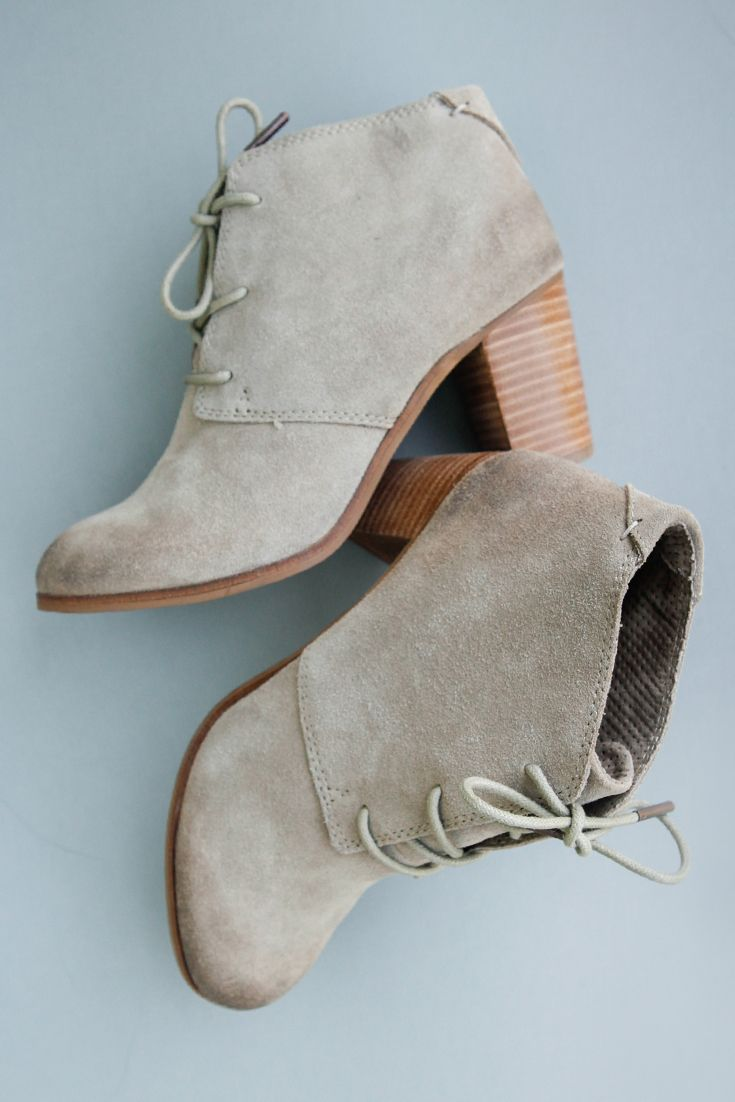 Step up your style this fall in the TOMS Lunata Lace-Up Booties.  Available in black and tan suede with a stacked wood heel.