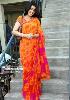 orange saree with pink/purple border