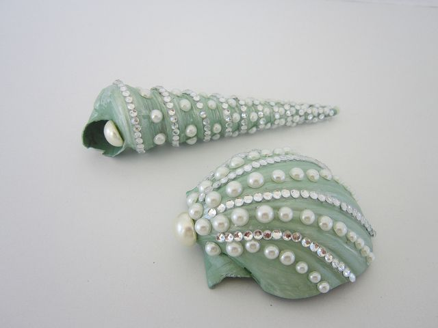 sage and pearl decorated shells, via Flickr.