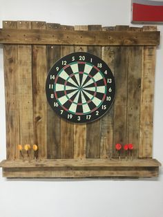 Scrap pallet wood dartboard holder with shelf for darts.