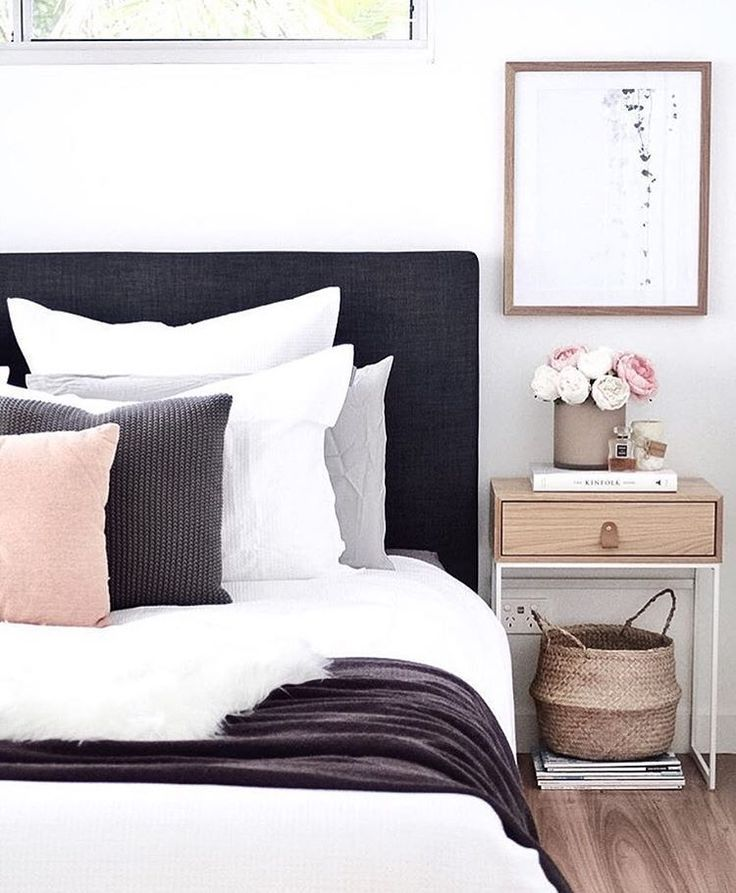 What a beautiful bedroom! We just love how simple and sleek the headboard is. It looks very pretty with the gray, stark white, and soft rosy pink accents!