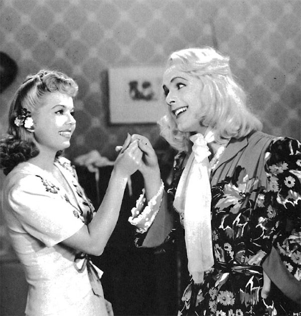 Johnny Downs (right) in the 1941 film All-American Co-Ed.