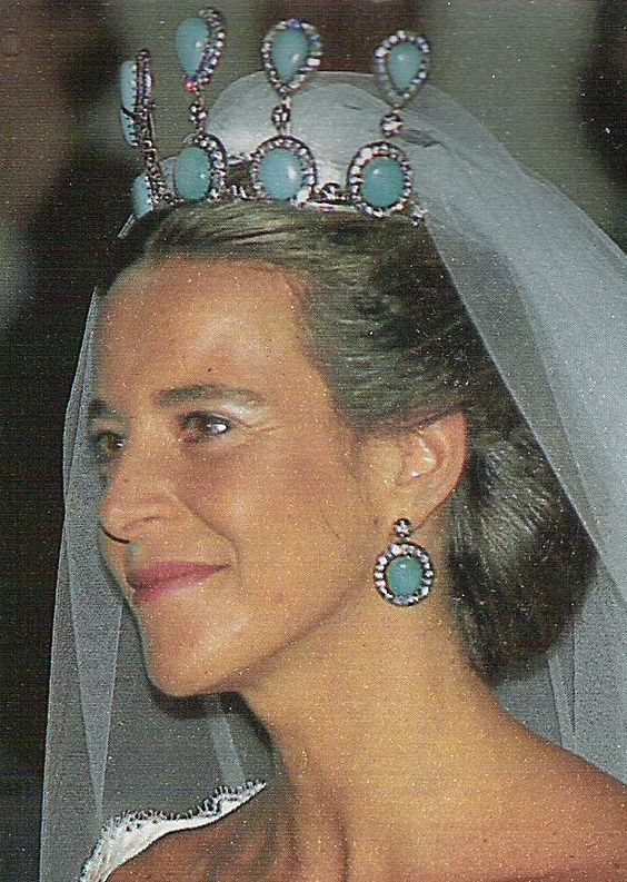 A fabulous and very tall diamond and turquoise tiara, with five upright diamond and turquoise pinnacles, circular at the base, then topped with pear-shaped turquoise; worn by Blanca Martinez de Irujo y Figueroa, when she wed Emanuele Bonomi on 1 June 1996