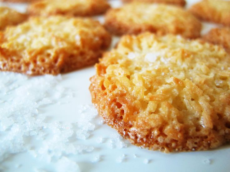 Crisp Coconut Cookies   [3 tablespoons (40g) butter, melted, coat  2 1/2 cups (200g) unsweetened shredded coconut thoroughly.  Beat 2 large eggs, add  2/3 cup (130g) sugar and beat med-high til light colored and fluffly.  Mix, put on parchment, 350,7-10m.  Use 1 – 1 1/2 teaspoons fleur de sel for sprinkling as soon as done.  When cool, put in air-tight container.]