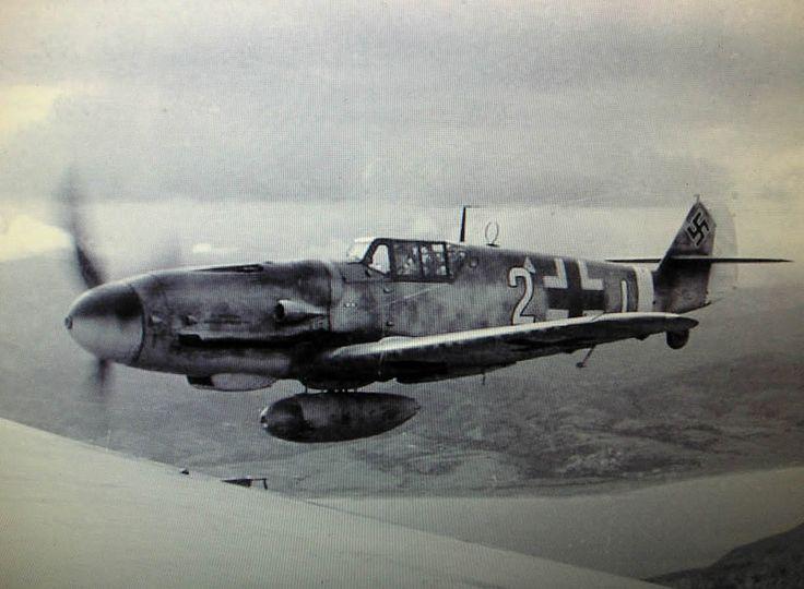 """photoyage: """" Messerschmitt Bf 109G-6 """"Weiß 2+I"""", piloted by Leutnant Josef-Emil Clade (27 kills), Staffelkapitän of 7./JG 27 'Afrika', photographed from a He 111 over Crete, Mediterranean Sea. 1 December 1943. """""""