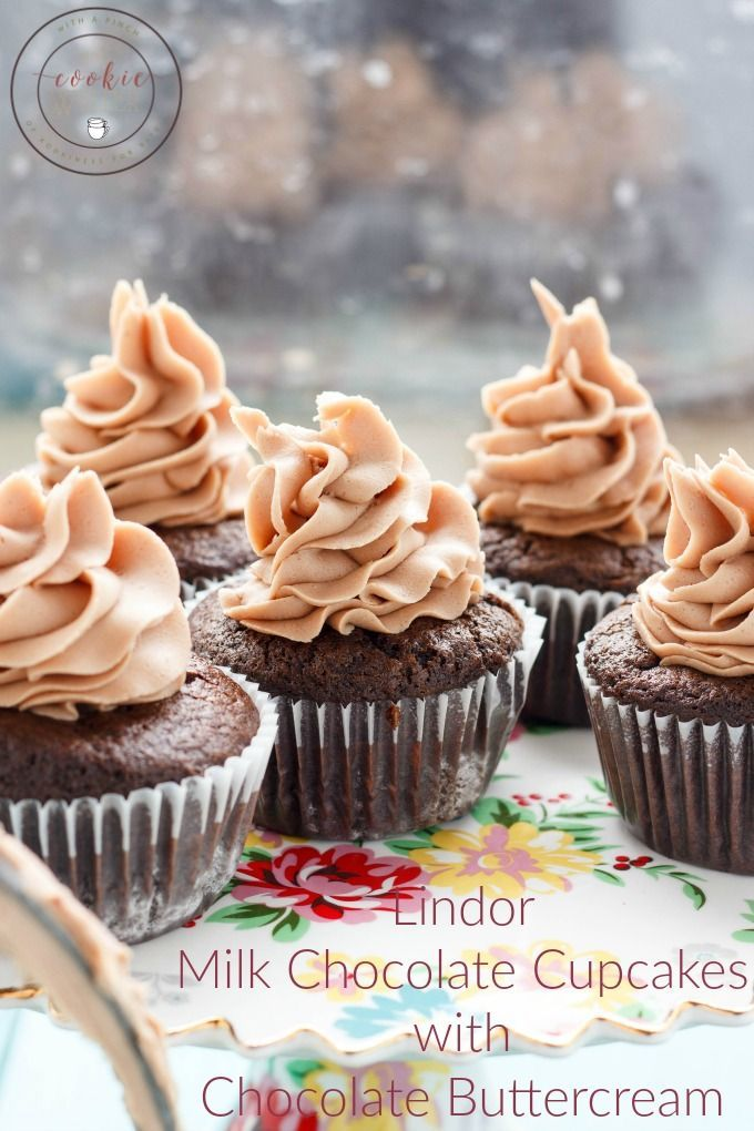 Rich, decadent, and dangerous! These Lindor milk chocolate cupcakes with chocolate buttercream are so worth breaking any diets for! | #dessert #chocolate #cupcakes | http://thecookiewriter.com