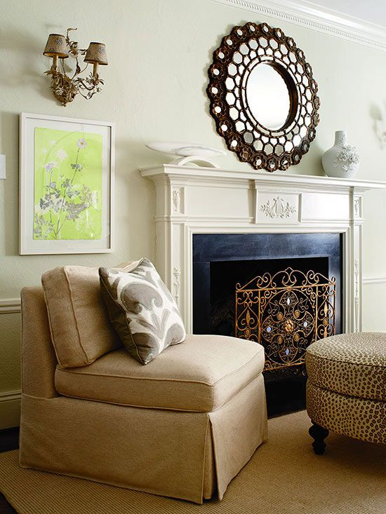 Style: Traditional A fireplace screen is an accessory that serves a purpose while also being stylish. Fireplace screens keep embers and sparks from getting on flooring and furniture. The intricate scrollwork of this screen emphasizes the molding of the fireplace and complements the geometric mirror./