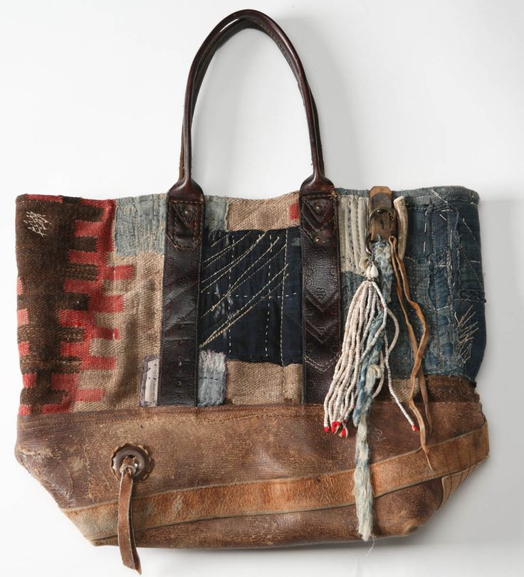 LOVE this fabulously collaged leather & fabric bag. Artist unknown.