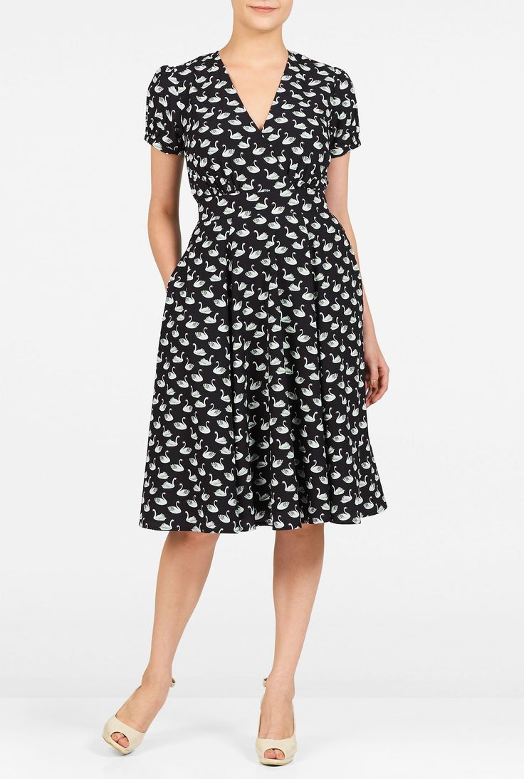 "eShakti Women's Swan print surplice crepe dress L-12 Short Black/white. Back zip with hook-and-eye closure, V-neck, Short sleeves with elastic cuffs, Inner shoulder bra strap keeps, Ruched surplice bodice, Banded waist, Side seam pockets, Below knee length, Lined in polyester moss crepe, Polyester, woven crepe, digital print, no stretch, lightweight, Machine wash cold, Model is wearing our size M8, cut for her height of 5'8.5"". Comes in Petites, Misses and Plus sizes for all heights...."