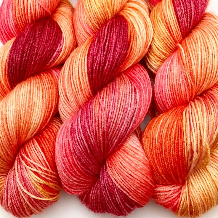 "A little ""Blood Orange Glow"" on Blueboo Fingering - a lovely BFL and Bamboo blend"