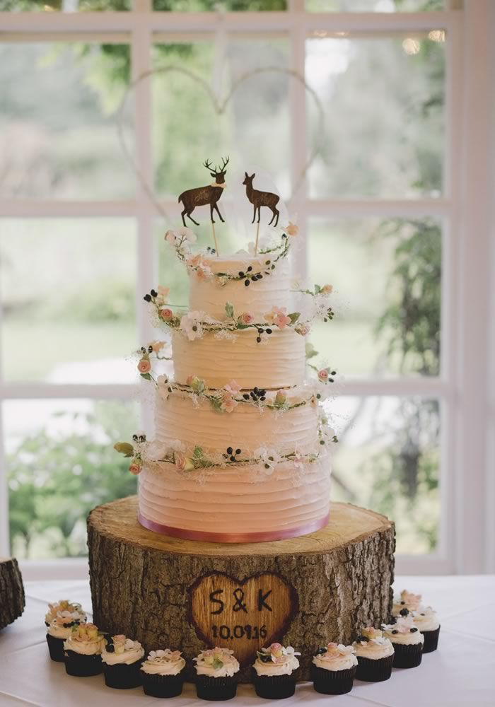 Looking for rustic wedding cake designs? Then you're in for a treat, whatever ideas you take from this amazing rustic wedding cake with flowers and cupcakes and a personalised log slice stand! We just LOVE the stag and deer cake toppers! This Wedding Prov