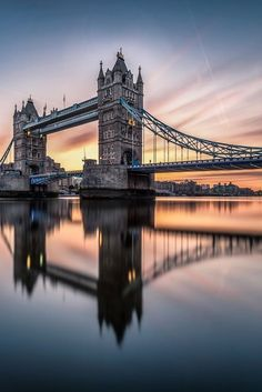 a reflective Tower Bridge in London.