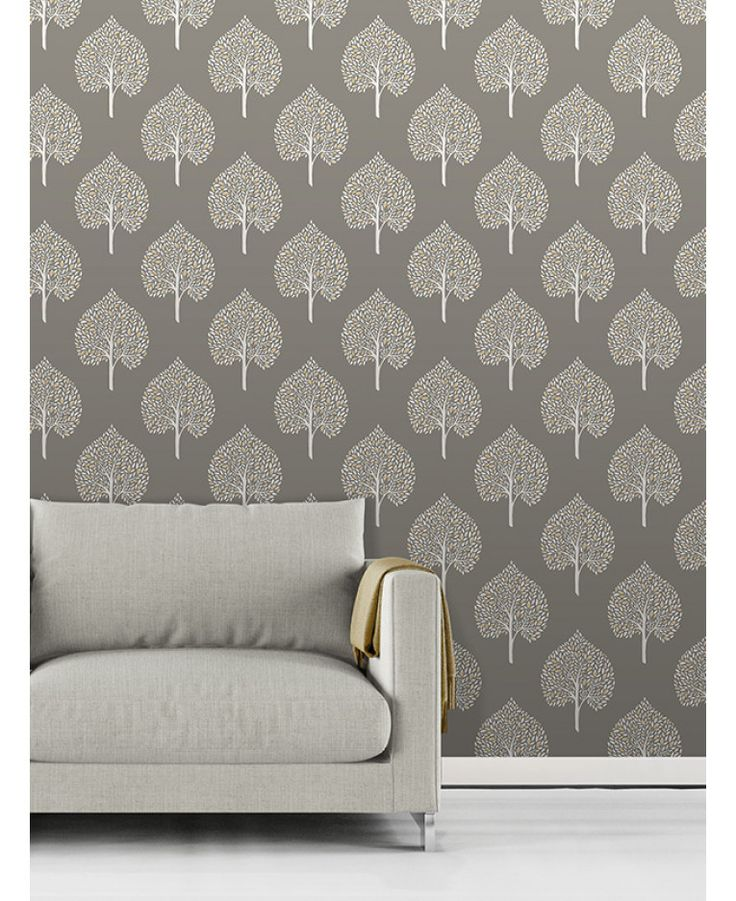 This Annabelle Tree Wallpaper has a stylish tree pattern in white with touches of yellow on a matte grey background. Free UK delivery available