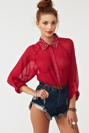 studded collar. red sheer top. leopard belt. high waist denim shorts. high bun. Love, love loooove.