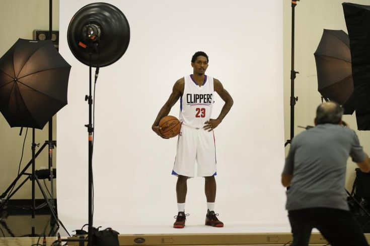 Los Angeles Clippers' Lou Williams poses for photos after an NBA basketball news conference Tuesday, July 18, 2017, in Los Angeles. (AP Photo/Jae C. Hong)