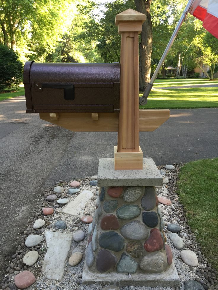 Craftsman style mailbox with cedar post and stone base.