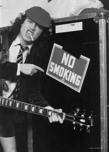 "Angus  (AC/DC)---Angus Young...You May Not Know His Name, But If You've Ever Partied to ""You Shook Me All Night Long,"" You Know This Axe Sound...For Sure...!!"