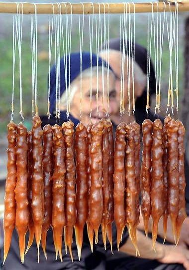Churchkhela is a home-made product. Georgians usually make it in Autumn when grape and nut is harvested since they are the main ingredients. It is a string of walnut halves that have been dipped in grape juice called Tatara or Phelamushi (grape juice thickened with flour), and dried in the sun. No sugar is used. Sometimes nuts or almonds are used in west Georgia. The shape looks like a candle or a sausage. Georgian warriors carried Churchkhelas with them because they contain many calories.
