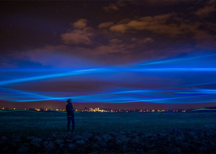 Dutch designer Daan Roosegaarde has created a lighting installation that resembles the aurora borealis above a flood channel of the Netherlands' River IJssel. The waving lines of light spread across 1.6 hectares. The LEDs are projected through lenses to focus the light. The sources are installed around the periphery of the area, positioned so the beams criss cross in midair as they slowly move up and down – powered by motors.