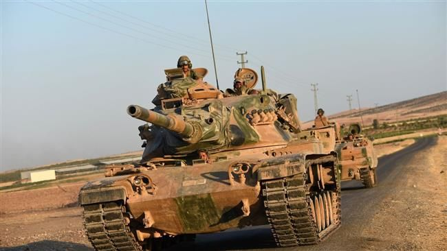 "Turkey deploying troops to Syria's militant-held Idlib. The Beirut-based al-Mayadeen TV channel cited sources as saying on Saturday that the Turkish military had sent a telegram to militant groups operating in Idlib and informed them of the deployment.  Turkish forces, it said, would not attack the Jabhat Fateh al-Sham terrorist group, formerly known as al-Nusra Front, but would engage in a ""diplomatic"" process and push them to evacuate Idlib and hand over their positions to the Turkish…"