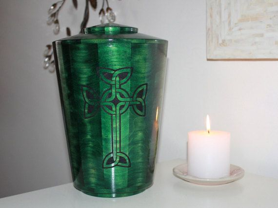 The Irish Iona Cross is a beautifully handcrafted custom urn made of Poplar wood and color-dyed green. An Iona Cross symbol is laser etched on the front and painted black. Many pieces of wood are skillfully cut, glued together, and turned on a lathe. The urn is sanded smooth and coated with a UV protective glossy finish. A wooden pedestal with brass nameplate is available separately for custom personalization here http://etsy.me/1qVUgUV.  Color, wood grain, and shape may vary from photo as…