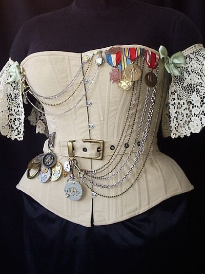 @: Lace and Corsets...nice touch with the chains, ribbons and gears