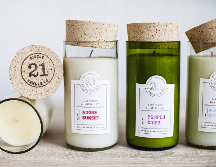 "All natural soy candles hand-poured into recycled wine bottle containers and topped with ""branded"" corks. Labels, blank letterpress label template with custom rubber stamps for each scent. Designed by Nudge."