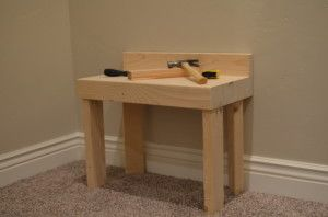 "Build a Kids Workbench for Under $15. I have a 3 year-old boy who loves to ""fix"" with me.  So, one afternoon I made him this workbench with a couple of 2×4's. Determine the right Size:  Have your child hold a tool out to gauge how high you will want …"