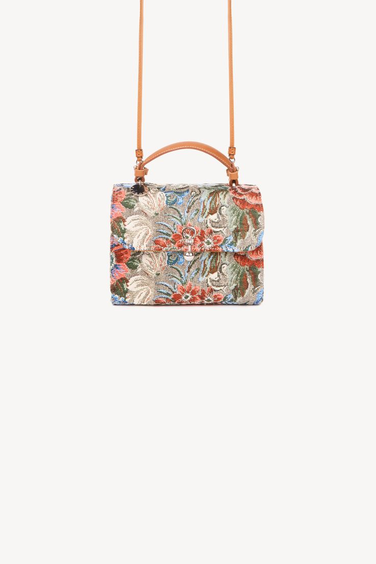 Its all about the vintage allure for this clutch in elegant gobelin jacquard fabric featuring a refined floral design. Perfect for holding all your essentials, this model is completed by a leather strap and metal buckle detail on the front.