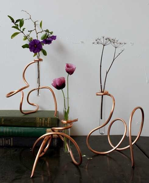 25 glass recycling ideas turning used bulbs and test tubes for Test tube flower vase rack