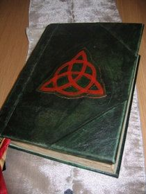 Must have; Book of Shadows from the Charmed TV Series. If I was talented enough I would make my own but sadly I'm not.....