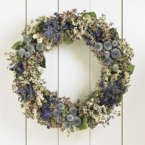 """Inspired by memories of Claude Monet's garden at Giverny, where banks of flowers in carefully orchestrated bands of color enchant the senses, our beautiful blue wreath includes air-dried salvia, echinops and larkspur interspersed with sprays of white achilla, Santa Cruz oregano and aromatic California bay. Protect from weather. 21"""" diam. A Williams-Sonoma exclusive."""