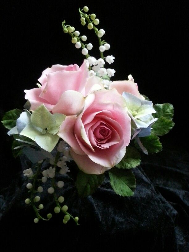 Sugar roses, hydrangeas and lily of the valley.
