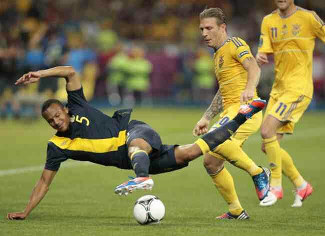 Ukraine 2 Sweden 1 in 2012 in Kiev. Sweden's Martin Olsson is fouled by Andriy Voronin in Group D at Euro 2012.