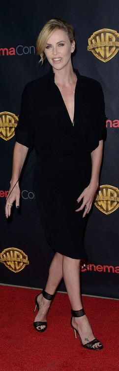Who made  Charlize Theron's black button down dress and mesh sandals?