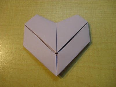 How to fold letter size paper into a heart.  I used to do this all the time.