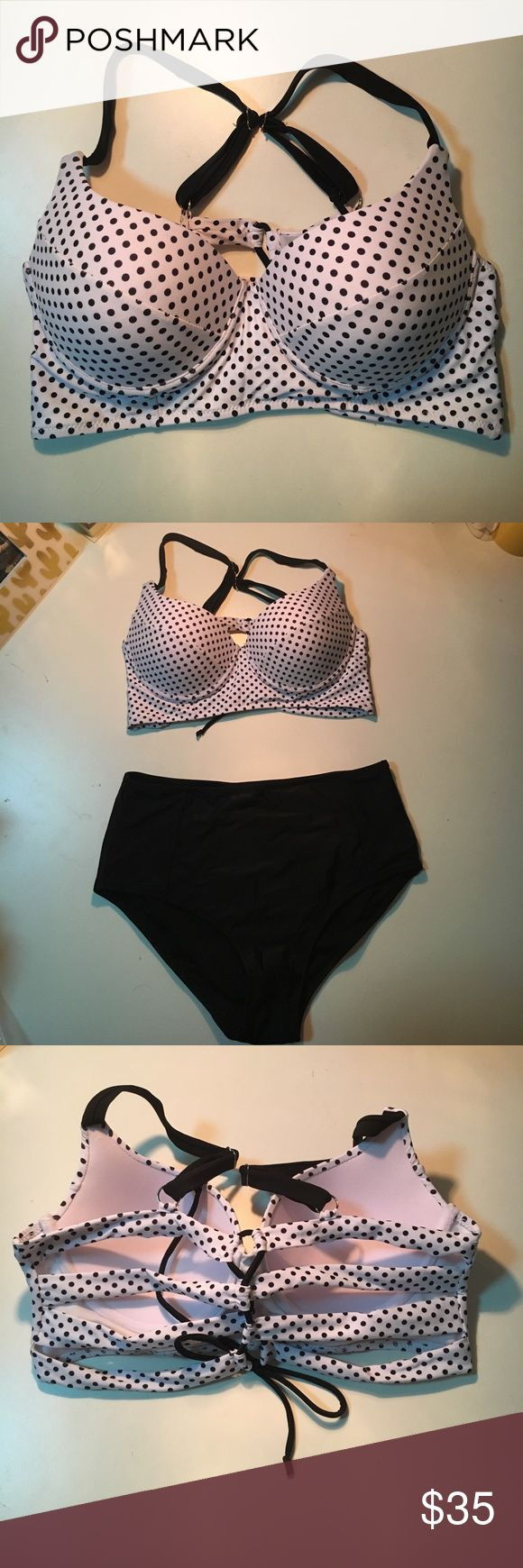 Polka dot bikini NWOT. Polka dot bikini top with high waisted black bottoms. Bought online but didn't fit my bust. Adorable swimsuit with strappy back. Swim Bikinis