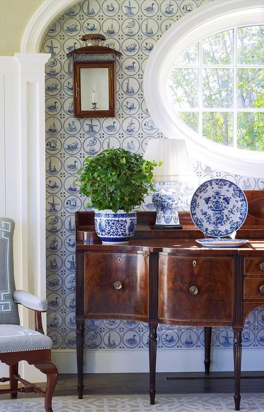 Interior Design : Anthony Baratta LLC | lovely blue and white wallpaper in this pretty, fresh traditional vignette with Hepplewhite or Sheraton sideboard and blue and white porcelains
