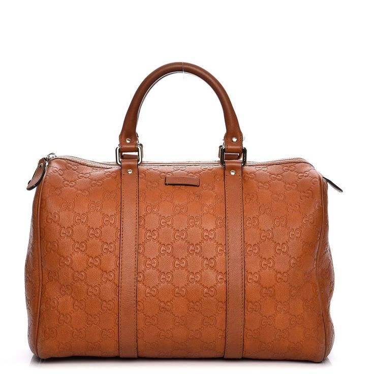 Item #: 210973. This chic Boston style tote is finely crafted of Gucci GG monogram embossed leather in brown. The bag features rolled leather top handles with polished brass hardware. The top zipper opens to a fabric interior with horsebit design print in green and red on a white background with patch pockets. | eBay!