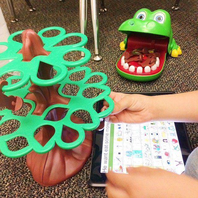 "AAC + music! Jumpin Monkeys + Crocodile Dentist could NOT have been a more perfect combination to sing ""5 Little Monkeys Swinging From The Tree."" Started with a model of 3 word combo ""He want eat"" to feed the alligator monkeys.. Then that evolved into a spontaneous 4 word combination, and THEN to a 5 word combination!! #aac #summerschool #slpbloggers #slpeeps #ASHAigers #slp2b #speechtherapy #thankfulthatkidsdontjudgemysinging"