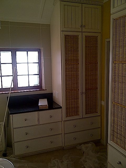 Doors with woven insert for ventilation