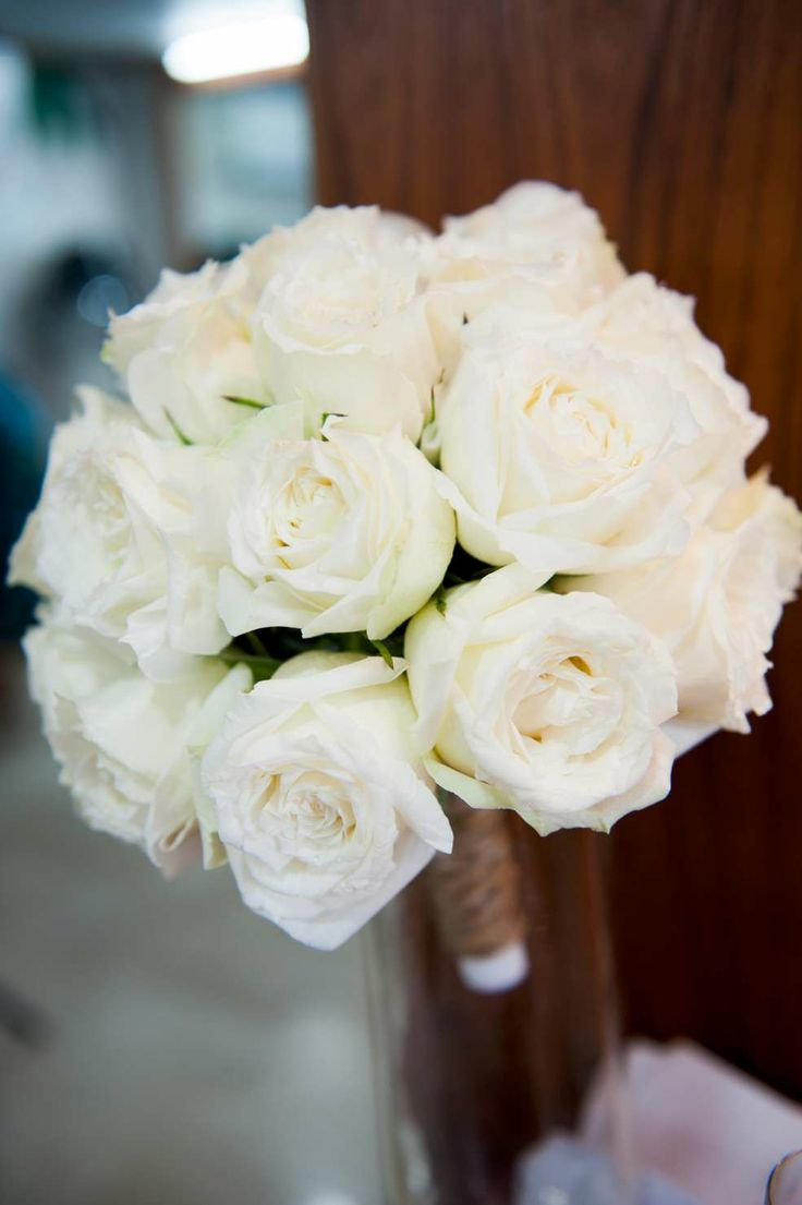 46 best wedding flowers images on pinterest wedding bouquets full white rose bouquet in a poesy style with natural twine wrapped stems faraway beach white rose bouquetwedding 2017flower izmirmasajfo
